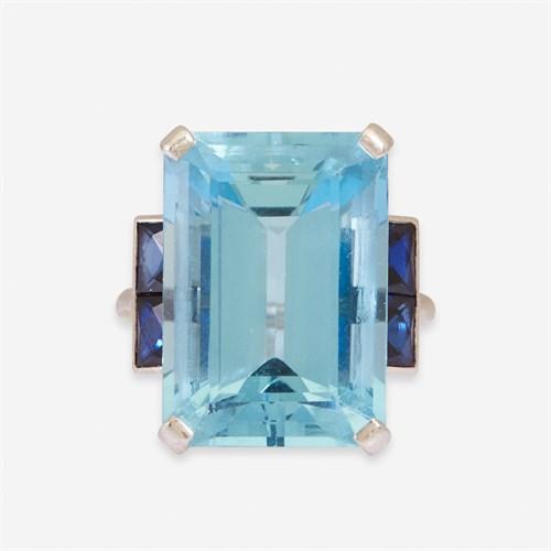 Lot 3 - An aquamarine, sapphire, and platinum ring, Cartier