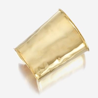 Lot 54 - An eighteen karat gold cuff bracelet