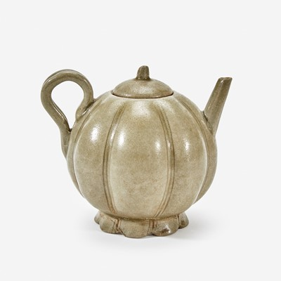 Lot 23 - A Chinese celadon-glazed melon-form small ewer and cover