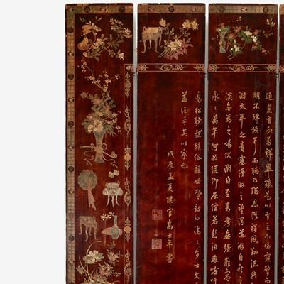 "Lot 81 - A Chinese carved twelve-panel ""Coromandel"" folding screen"