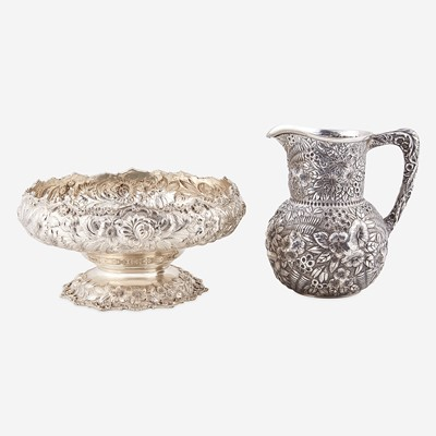 Lot 180 - A floral repoussé sterling silver water jug and center bowl