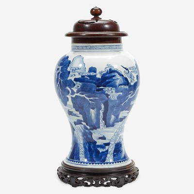 Lot 6 - A Chinese blue and white porcelain vase with carved wood cover and stand