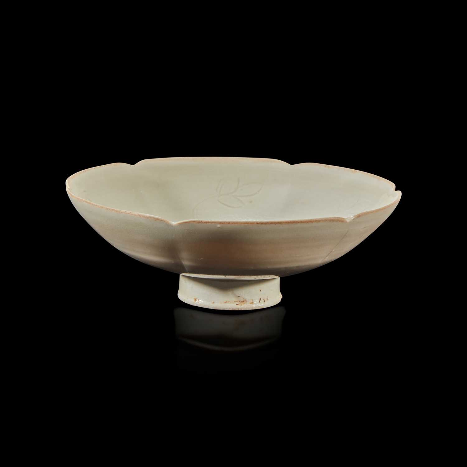 Lot 25 - A Chinese lobed Ding ware stem cup
