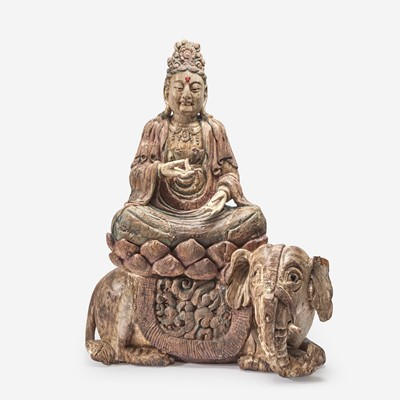 Lot 64 - A large carved and polychromed wood figure of the Bodhisattva Puxian 木雕普贤菩萨坐像