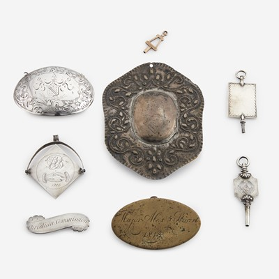 Lot 124 - A group of eight silver, gold, and brass fraternal and administrative fob pendants and buckles
