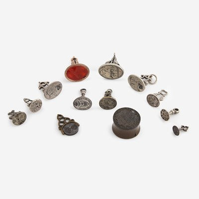 Lot 125 - A collection of thirteen silver, gold, and metal fob seals/seals