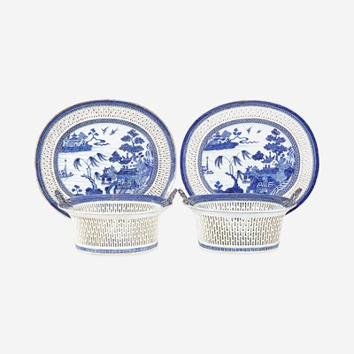 Lot 100 - A pair of Chinese Export porcelain gilt-decorated blue and white reticulated baskets and stands