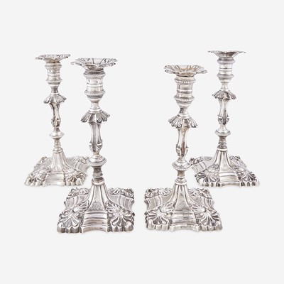 Lot 128 - Two pairs of George III sterling silver candlesticks