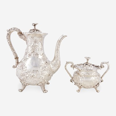 """Lot 178 - A """"Grape"""" pattern repoussé sterling silver teapot and covered sugar bowl"""