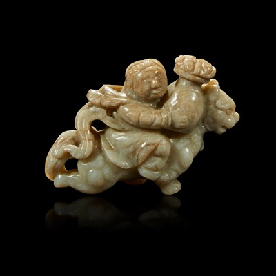 Lot 86 - A Chinese greyish white jade carving of a foreigner on a mythical beast