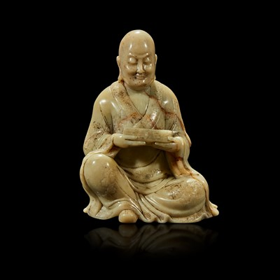 Lot 109 - A finely-carved Chinese soapstone figure of a seated luohan