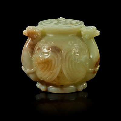 """Lot 90 - A Chinese carved greyish celadon and beige jade archaistic """"Birds"""" vessel and cover"""