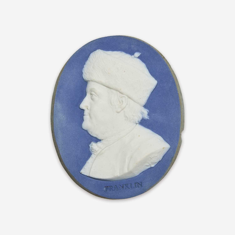 Lot 34 - A Wedgwood & Bentley blue and white Jasperware portrait medallion of Benjamin Franklin (1706-1790)