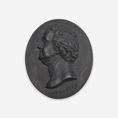 Lot 38 - A Wedgwood & Bentley black basalt portrait medallion of Benjamin Franklin (1706-1790)