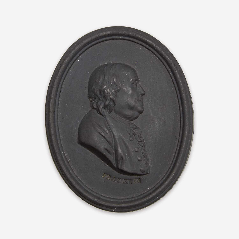 Lot 36 - A Wedgwood black basalt portrait medallion of Benjamin Franklin (1706-1790)