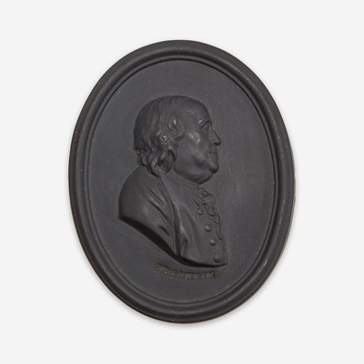 Lot 36 - A Wedgwood black basalt portrait medallion of Benjamin Franklin (1706-1790)