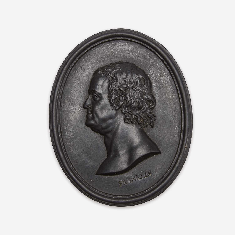 Lot 37 - A Wedgwood & Bentley black basalt portrait medallion of Benjamin Franklin (1706-1790)