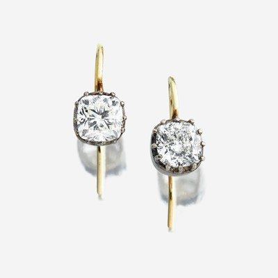 Lot 141 - A pair of diamond drop earrings