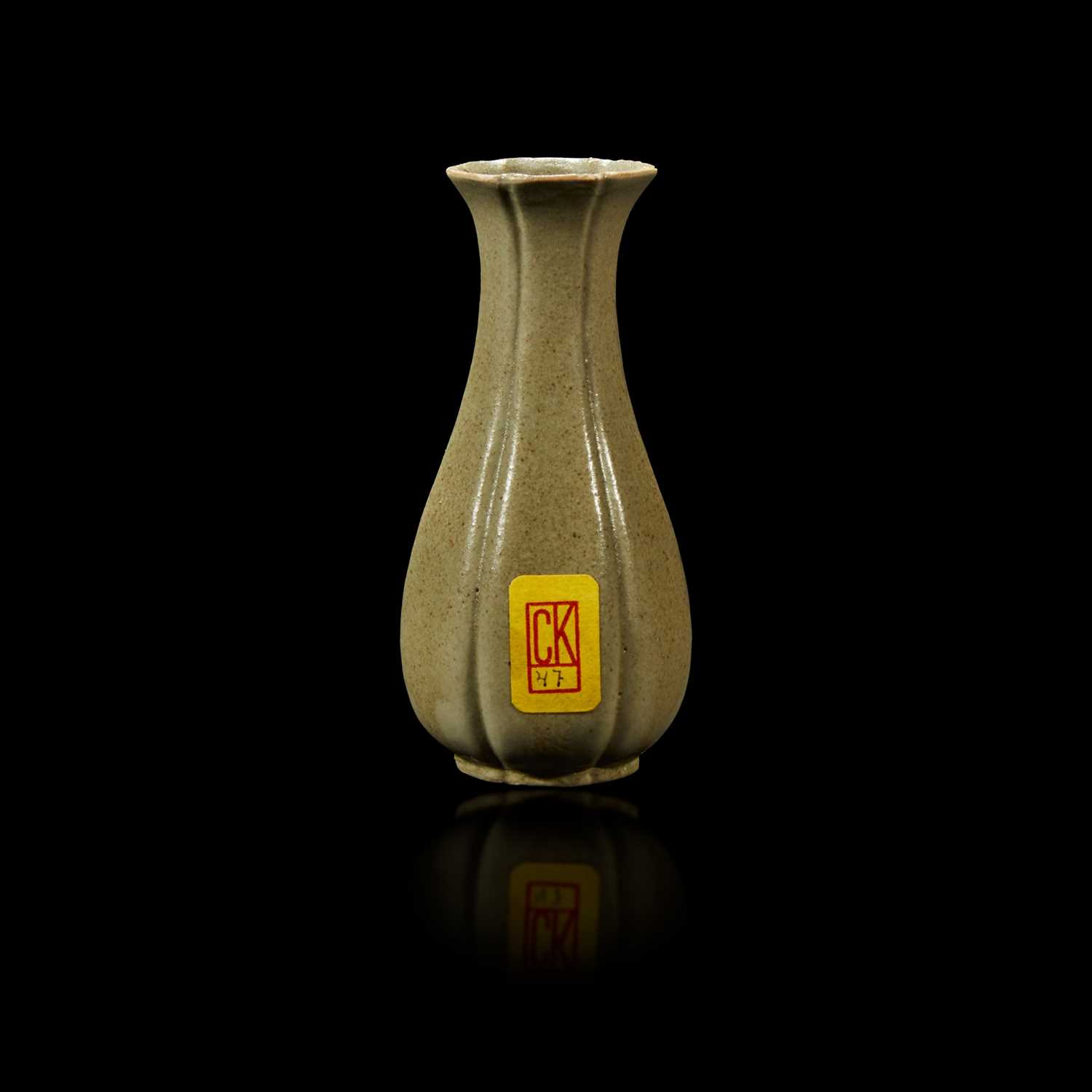 Lot 30 - A Chinese grey-green-glazed lobed miniature vase
