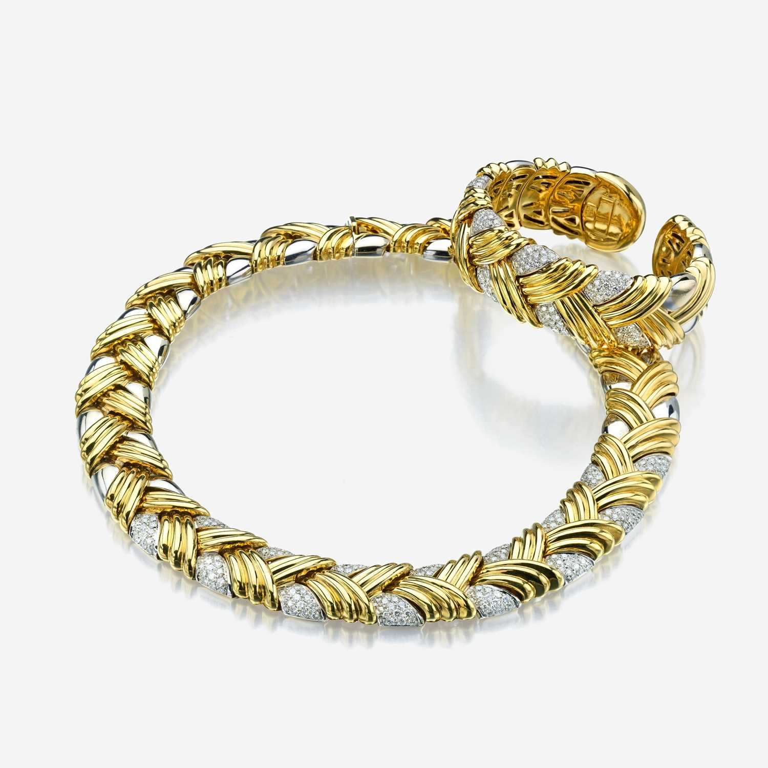 Lot 57 - An eighteen karat two tone gold and diamond necklace with matching bracelet
