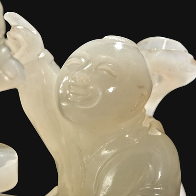 """Lot 89 - A Chinese carved white jade """"Boys"""" vase and cover"""