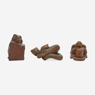 Lot 138 - Three Japanese carved wood netsuke: measure and toad, snake and toad, monk and jar