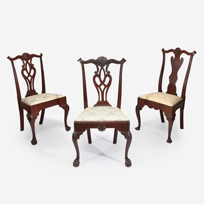 Lot 52 - Three Queen Anne / Chippendale carved walnut side chairs