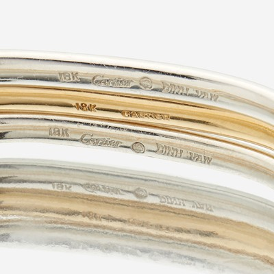 Lot 65 - A collection of three eighteen karat gold bangles, Cartier