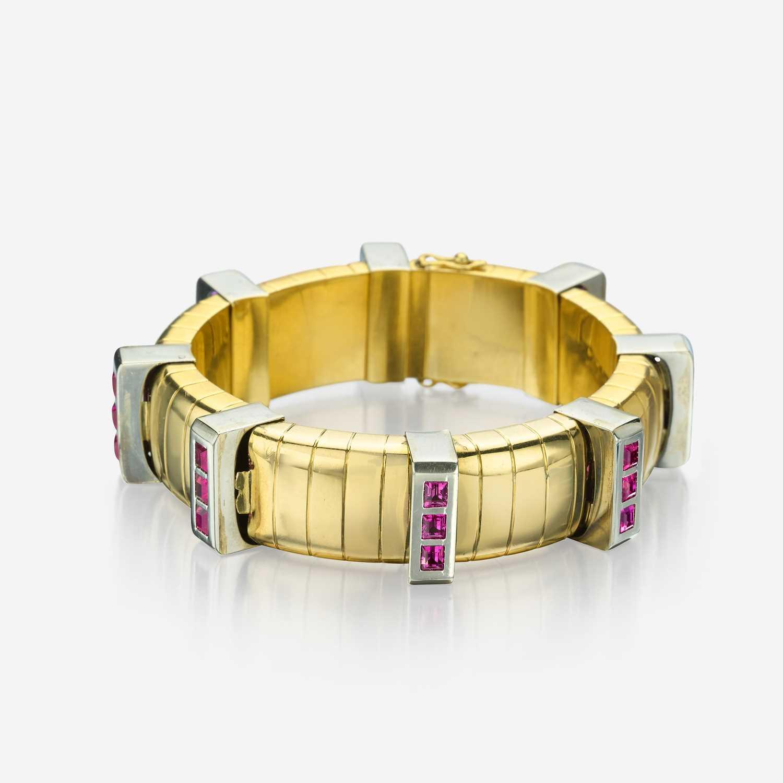 Lot 69 - An eighteen karat bicolor gold and pink sapphire bracelet