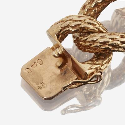 Lot 53 - An eighteen karat gold curb link bracelet, Cartier