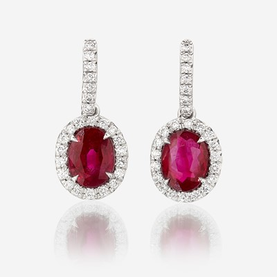 Lot 101 - A pair of ruby, diamond, and platinum earrings