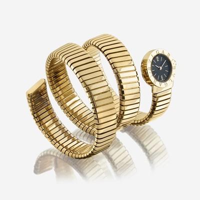 Lot 118 - An eighteen karat gold, Tubogas bracelet wristwatch, Bulgari