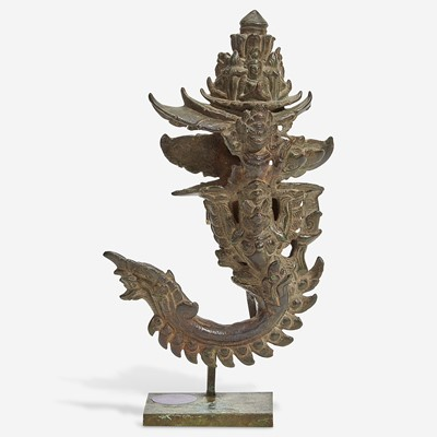 Lot 118 - A Khmer bronze palanquin hook with later stand