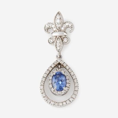 Lot 99 - A sapphire, diamond, and eighteen karat white gold pendant