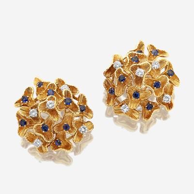 Lot 36 - A pair of eighteen karat gold, sapphire, and diamond ear clips
