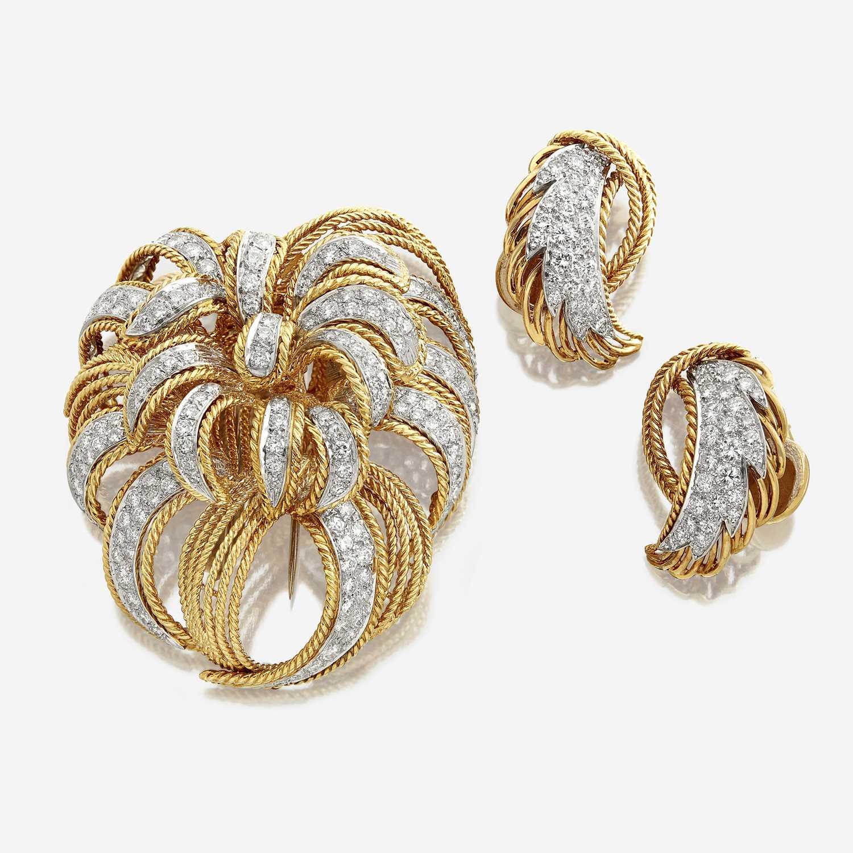 Lot 39 - An eighteen karat gold and diamond brooch and matching earrings