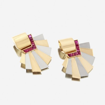 Lot 22 - A pair of Retro eighteen karat bicolor gold and ruby ear clips
