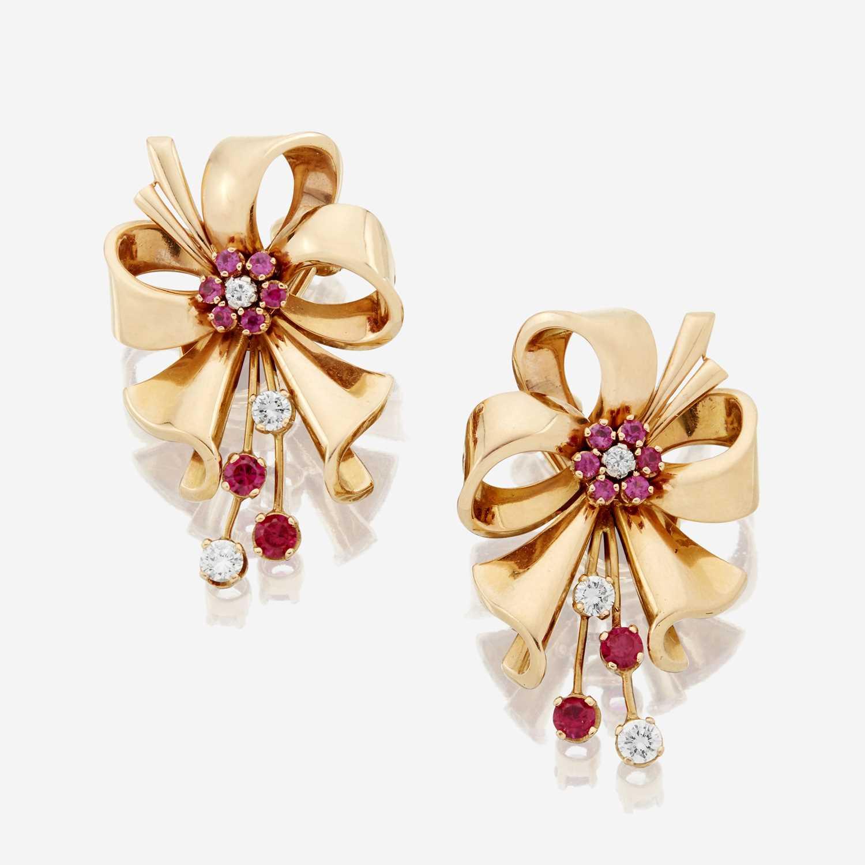 Lot 26 - A pair of Retro eighteen karat gold and diamond earrings