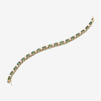 Lot 39 - A diamond, emerald, and fourteen karat gold bracelet