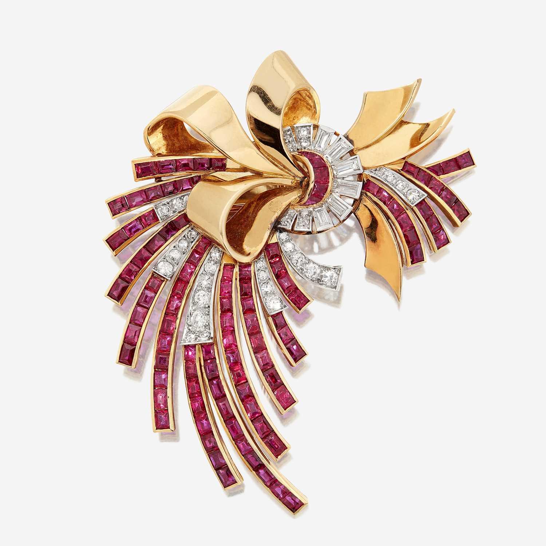 Lot 25 - An eighteen karat gold, ruby, and diamond brooch