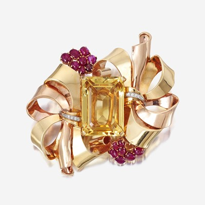 Lot 24 - A Retro fourteen karat bicolor gold, citrine, and ruby brooch