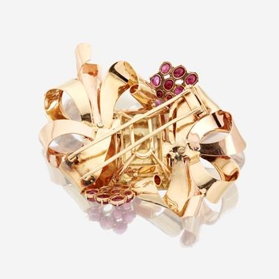 Lot 24 - A Retro fourteen karat bicolor gold, citrine, and ruby brooch