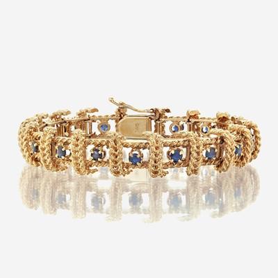 Lot 38 - A fourteen karat gold and sapphire bracelet