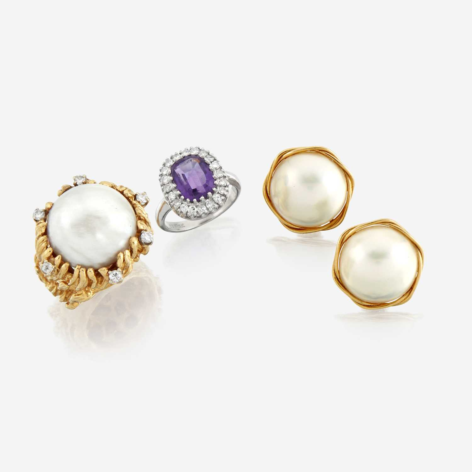 Lot 47 - A collection of fourteen karat gold and gem-set jewelry