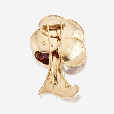 Lot 27 - A Retro fourteen karat gold, ruby, and diamond brooch
