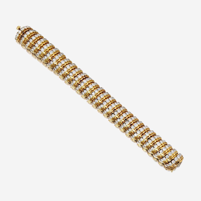 Lot 41 - An eighteen karat gold and diamond bracelet, Van Cleef & Arpels