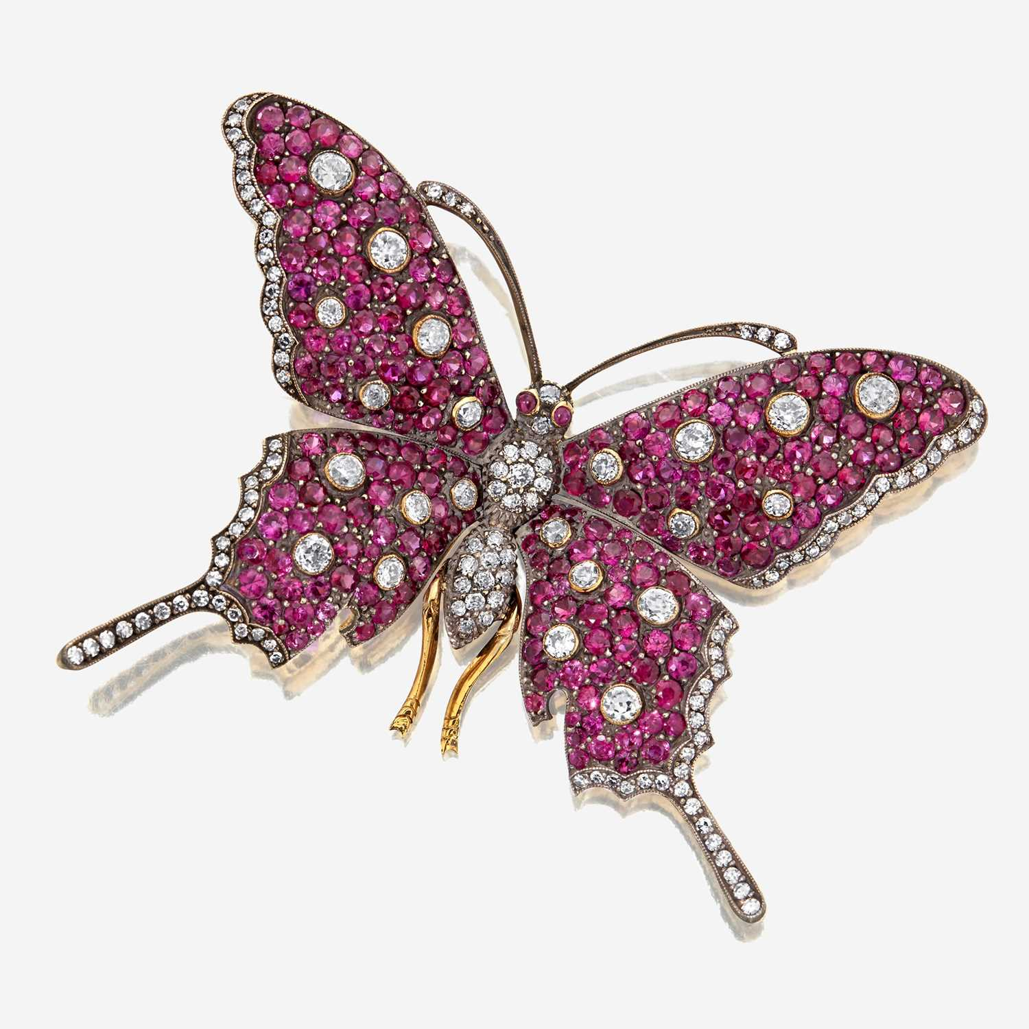 Lot 15 - A diamond and ruby brooch