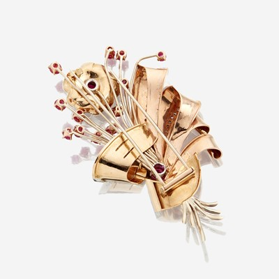 Lot 23 - A Retro fourteen karat bicolor gold, ruby, and diamond brooch