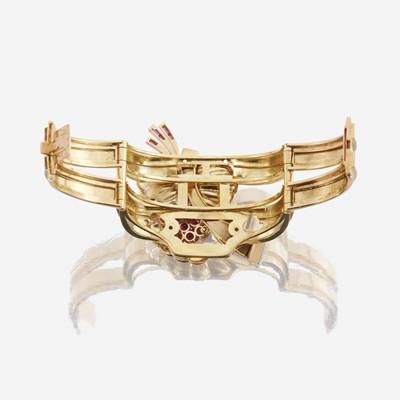 Lot 16 - A Retro eighteen karat gold, ruby, and diamond bangle bracelet