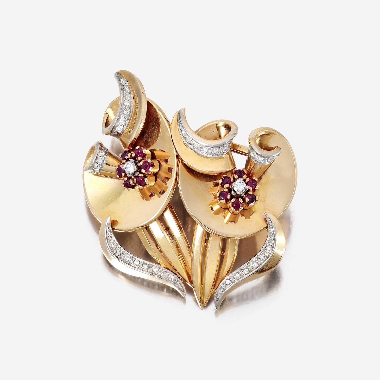 Lot 18 - A Retro eighteen karat gold, diamond, and ruby clip/brooch